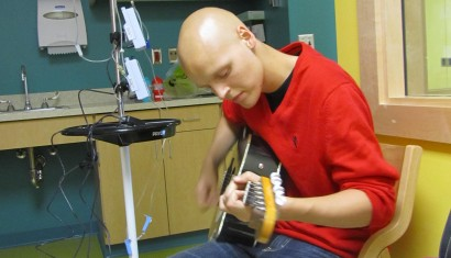 Zach playing guitar in the Hospital